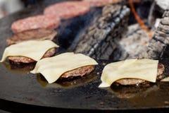 Roasting burgers outdoors Stock Photos