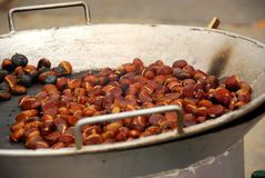 Roasting chestnuts Stock Photography