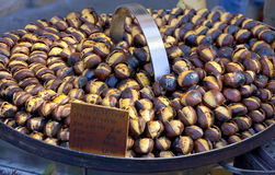 Roasting chestnuts on the grill by a street vendor in Rome Stock Photo