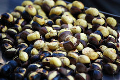 Roasting chestnuts in a hot pan. Chestnuts roasting in a hot pan Royalty Free Stock Photos