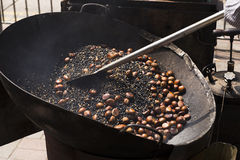 Roasting of chestnuts on the street Royalty Free Stock Photography