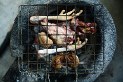 Roasting chicken on clay stove. Stock Image
