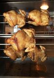 Roasting chicken in the oven. Photograph of roasting chicken in the oven Royalty Free Stock Photography