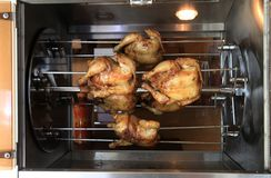 Roasting chicken in the oven Stock Photos