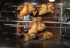 Roasting chicken in the oven Stock Photo