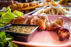 Roasting chicken,Som Tum Thai.Thai style papaya salad spicy food. And Fried fish for lunch. Traditional Thai Food royalty free stock photography