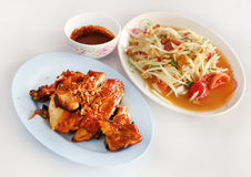 Roasting chicken and spicy papaya salad Royalty Free Stock Images