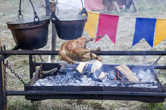 Roasting Chicken on spit Royalty Free Stock Images