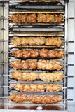 Roasting chickens. On a vertical grill royalty free stock image