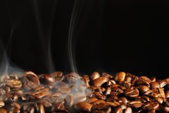 Roasting coffee. With smoke and black background stock photo