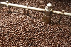Roasting Coffee Beans. Fresh coffee beans in a roasting machines Stock Image
