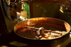 Roasting coffee. Coffee beans in a roasting machine. stock photography