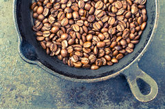Roasting coffee in the kitchen Royalty Free Stock Photos