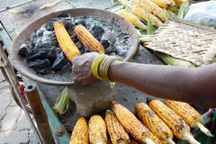 Roasting corn on the cob Stock Photos