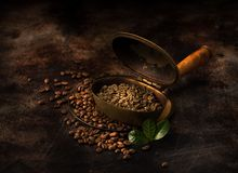 Green coffee in a vintage roaster. Roasting green coffee in a vintage roaster royalty free stock photography