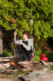 Roasting marshmallows. Boy sitting by a campfire roasting marshmellows Royalty Free Stock Photography
