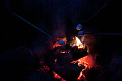 Roasting marshmallows at a campfire. Roasting marshmallows over a camp fire. High ISO shot. Contains grain Stock Photography