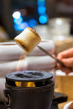Roasting marshmallows. Over fireplace Royalty Free Stock Photography