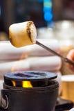 Roasting marshmallows. Over fireplace Royalty Free Stock Photos