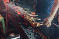 Roasting meat, chicken and mutton satays at the night market in Kuala Lumpur, Malaysia.  Royalty Free Stock Images