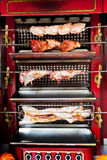 Roasting meat on spit Royalty Free Stock Photography