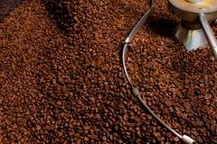 Roasting process of coffee, production. Roasting process of coffee, screening and cooling in the hopper Royalty Free Stock Photo