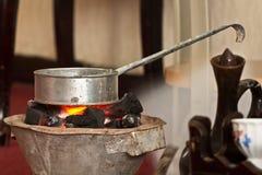 Roasting raw coffee using coal Royalty Free Stock Photo