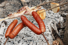 Roasting sausage Stock Images