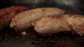 Roasting sausages stock video