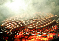 Roasting saussage on a barbecue Stock Image