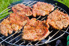 Roasting steaks on bbq Royalty Free Stock Photo