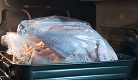 Roasting a turkey in a bag Royalty Free Stock Photography
