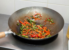 Roasting vegetables on a frying pan. Frying vegetables in a pan for Japanese cuisine Royalty Free Stock Image