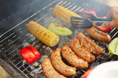 Roasting vegs and sausages Royalty Free Stock Photography