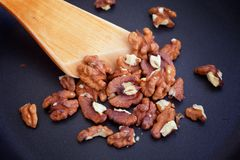 Roasting Walnuts on a pan royalty free stock photo