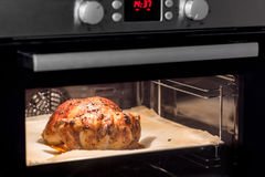 Roasting whole chicken in the oven. Royalty Free Stock Photos