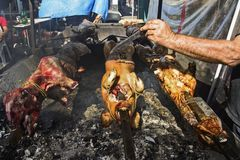 Roasting pork and sheep on a grill Stock Photography