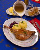 Roasty duck leg with braised red cabbage and dumplings Stock Images