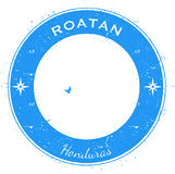 Roatan circular patriotic badge. Grunge rubber stamp with island flag, map and name written along circle border, vector illustration Royalty Free Stock Photo