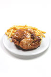 Roated chicken wiht fries Stock Photos