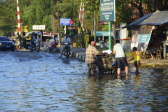 Rob flood in Semarang Kaligawe Region. Tides or tidal flood was already about a month pooled Highway Kaligawe Semarang. This path is the northern coastal road Royalty Free Stock Photo
