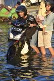 Rob flood in Semarang Kaligawe Region. Tides or tidal flood was already about a month pooled Highway Kaligawe Semarang. This path is the northern coastal road Stock Photo