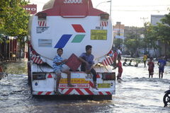 Rob flood in Semarang Kaligawe Region. Tides or tidal flood was already about a month pooled Highway Kaligawe Semarang. This path is the northern coastal road Stock Images