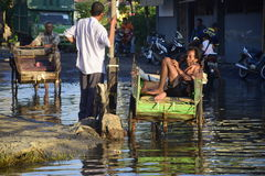 Rob flood in Semarang Kaligawe Region. Tides or tidal flood was already about a month pooled Highway Kaligawe Semarang. This path is the northern coastal road Royalty Free Stock Photography