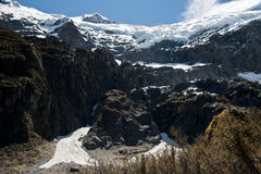 Rob roy glacier portrait. Dramatic rob roy glacier hanging over mountain face, new zealand Stock Photography