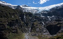 Rob Roy Glacier with waterfalls made of melting water in New Zealand stock image