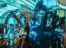 Robôs de soldadura Fotos de Stock Royalty Free