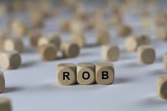 Rob - Würfel mit Buchstaben, Zeichen mit hölzernen Würfeln Stockbilder