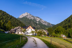 Idyllic landscape in the Alps, Roban farmstead, Slovenia. Robanov kot, Slovenia is a protected traditional Alpine village in Idyllic Landscape and preserved as Royalty Free Stock Images