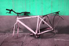 Robbed. A bicycle plundered by the green wall Royalty Free Stock Image